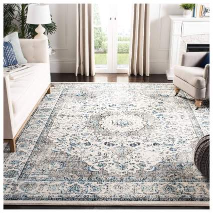 distressed white and blue area rug