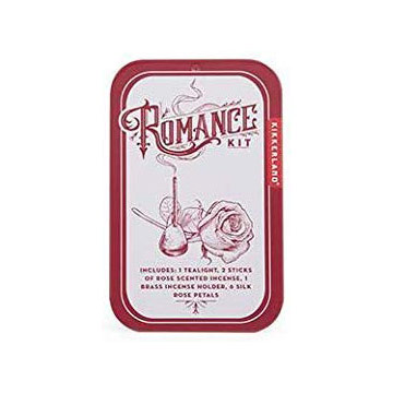 Red tin that says Romance Kit