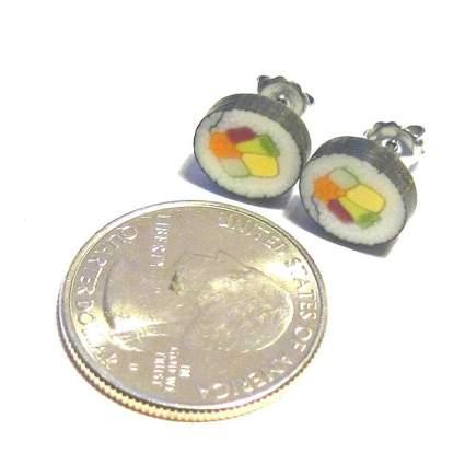 Tiny sushi earrings next to a quarter
