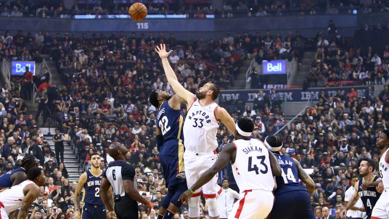 Derrick Favors, Pelicans, jumping tip-off against Toronto's Marc Gasol