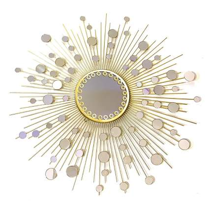 gold and glass starburst mirror