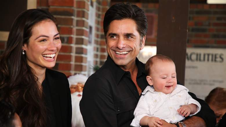 John Stamos, wife Caitlin McHugh, and son attend an event.