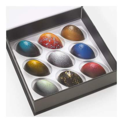 Colorful Rimini chocolate truffles in a square box