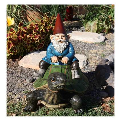garden gnome riding a giant turtle