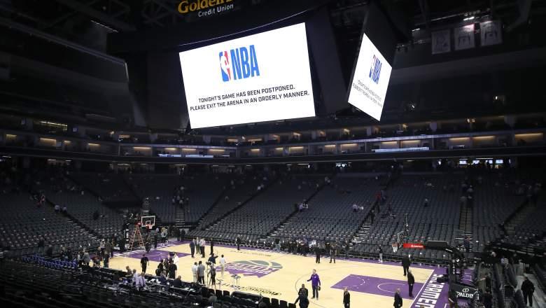 The Golden 1 Center scoreboard informs fans of Kings-Pelicans postponement