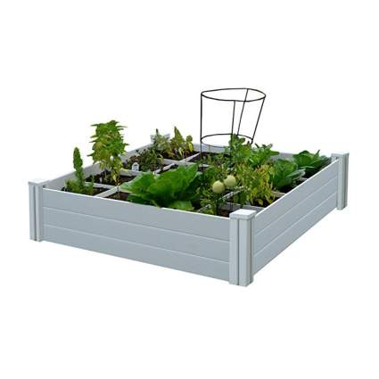 white raised garden box with planting grid