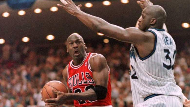 Michael Jordan, left, drives against Shaquille ONeal