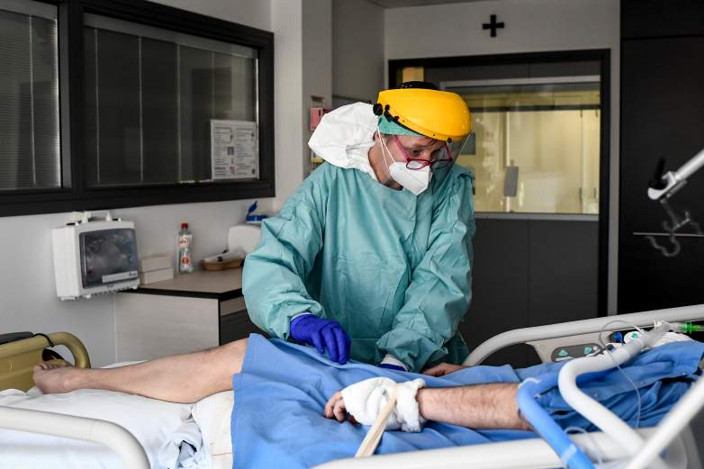 Nurse caring for COVID-19 patient