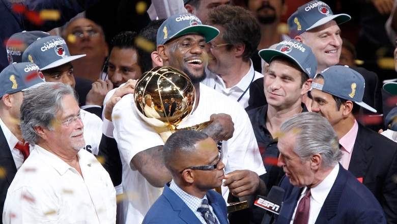 LeBron James, holding his first NBA Championship trophy