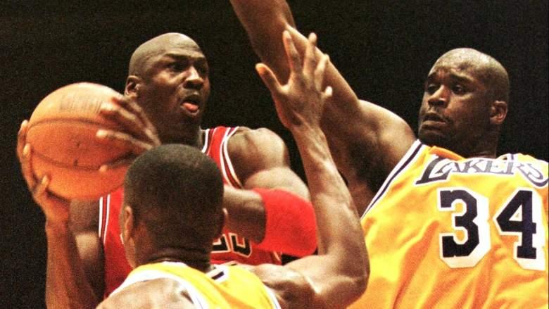 Bulls guard Michael Jordan, at left, drives against Lakers center Shaquille O'Neal