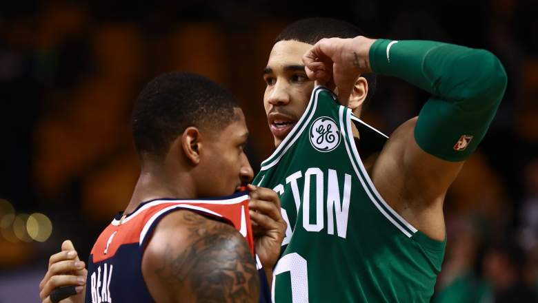 Celtics forward Jayson Tatum, at right, taunts friend and Wizards guard Badley Beal