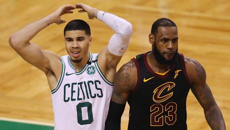 Celtics star Jayson Tatum, at left, with LeBron James in 2018