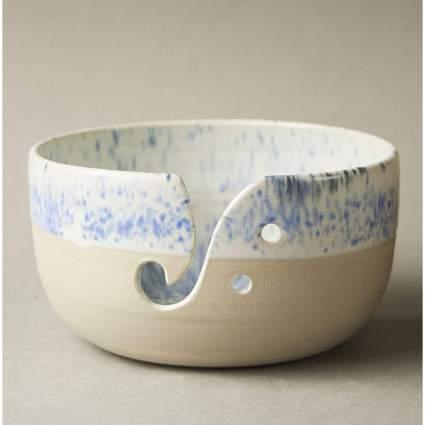 Tan and blue ceramic wool bowl