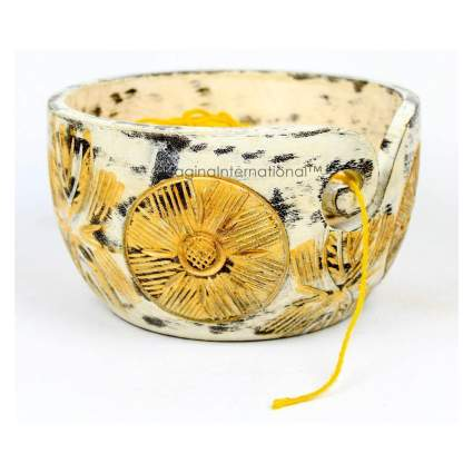 Yellow painted wooden bowl with flowers