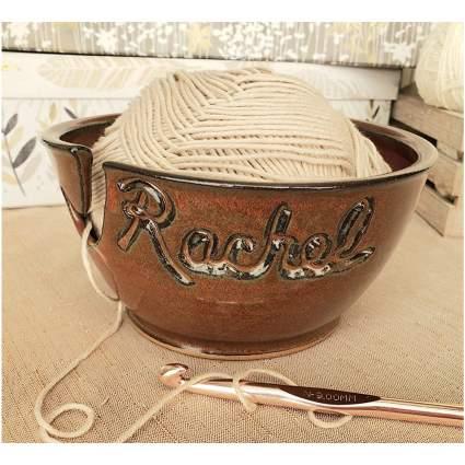 Bowl of yarn that says Rachel on it