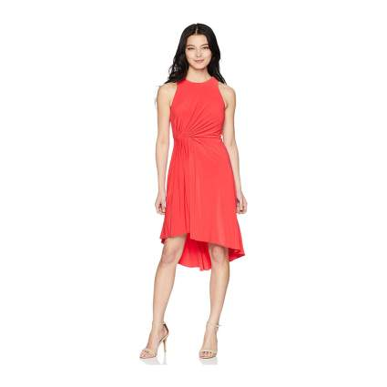 Woman in coral fit and flare dress