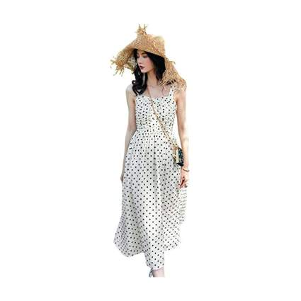 Woman in white polka dress and straw hat
