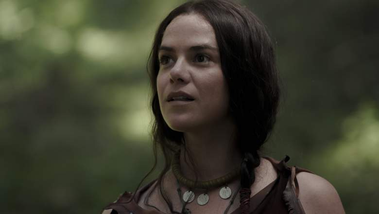 """Mari (Kaniehtiio Horn) watches Sel as they pause in the woods in """"Barkskins"""" episode 2."""