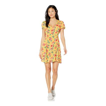 Woman in yellow floral Billabong dress