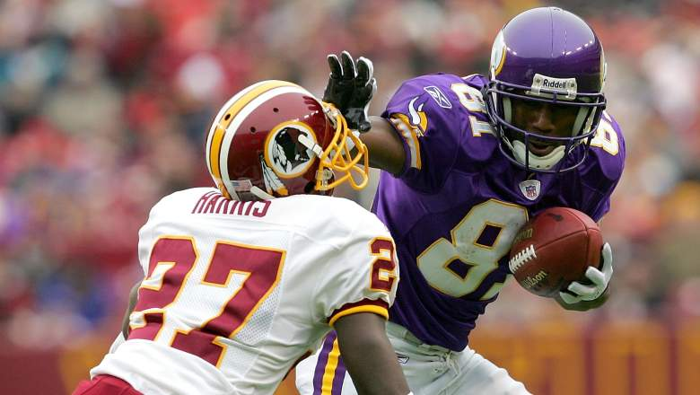 Vikings wide receiver Nate Burleson stiff arms Walt Harris of the Washington Redskins during a game on January 2, 2005 at FedEx Field in Landover, Maryland.