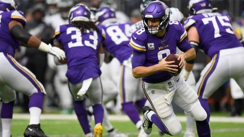 Minnesota Vikings quarterback Kirk Cousin drops back for a pass.