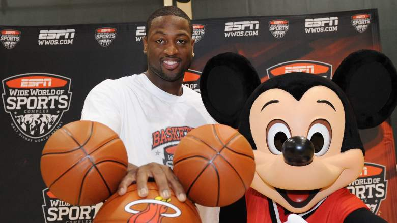 Former NBA star Dwyane Wade and Mickey Mouse at Disney World