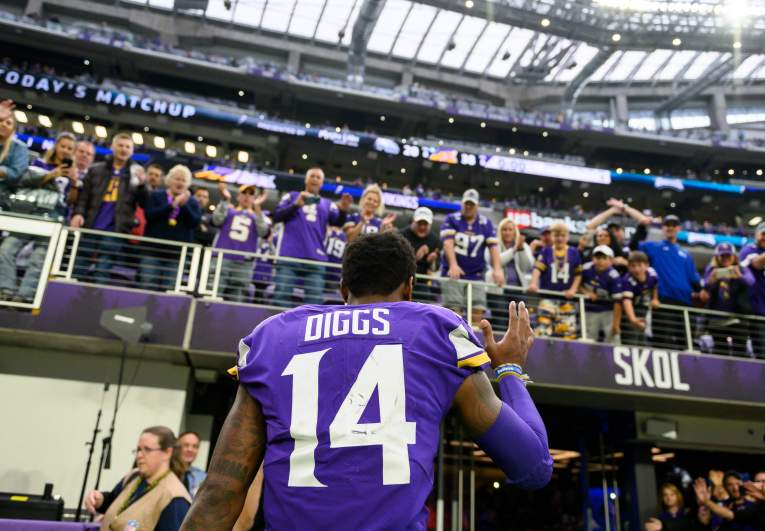 Stefon Diggs bids fans farewell as he exits the field at U.S. Bank Stadium