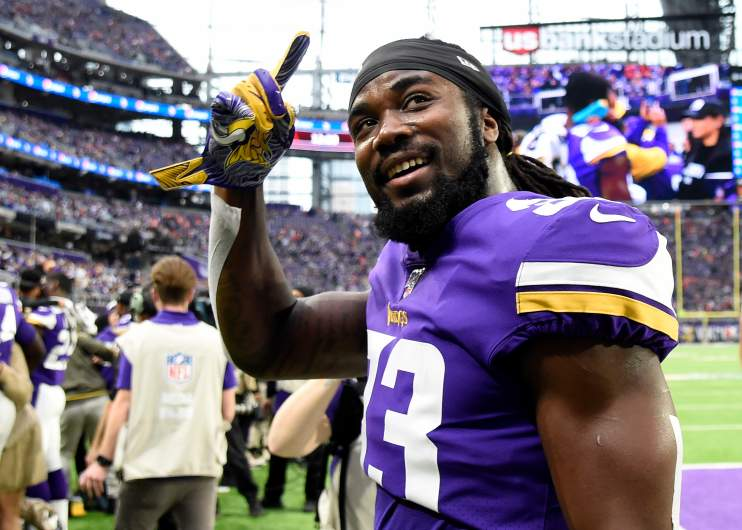 Dalvin Cook greets fans on the U.S. Bank Stadium field