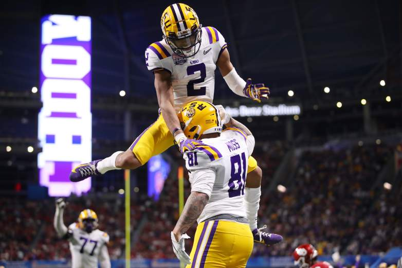 LSU wide receiver Justin Jefferson celebrates with teammate