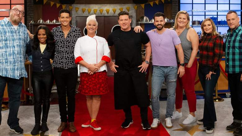 Mentors Anne Burrell and Tyler Florence pose with recruits Brian Posehn, Robin Givens, Wells Adams, Johnny Bananas, Bridget Everett, Sonja Morgan and Dave Coulier, as seen on Worst Cooks in America, Season 19.
