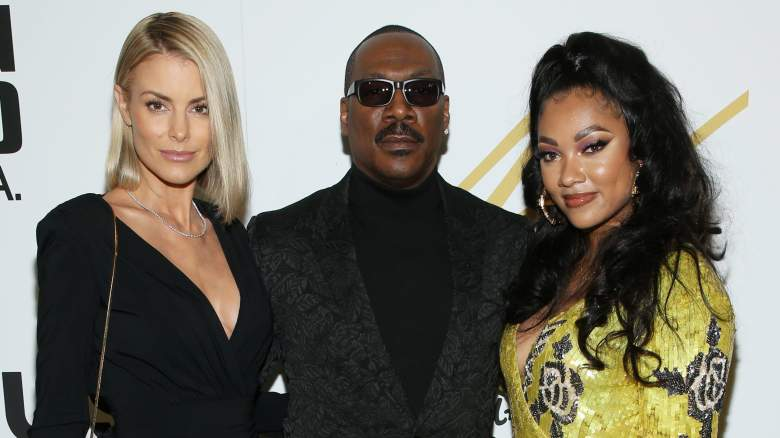 Paige Butcher, Eddie Murphy, and Bria Murphy attend the Eddie Murphy X ARTUS Gallery Exhibition Opening Night at East Angel Gallery