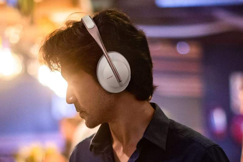 Man wearing Bose wireless noise canceling headphones