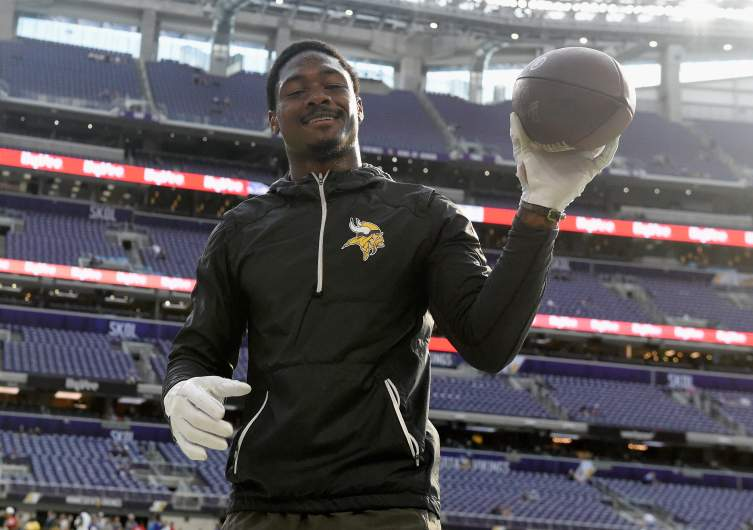 Diggs playing catch with a fan