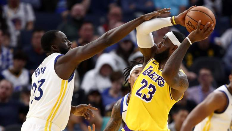 Draymond Green, at left, guards the Lakers' LeBron James