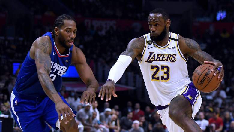 Clippers star Kawhi Leonard, at left, guards LeBron James of the Lakers