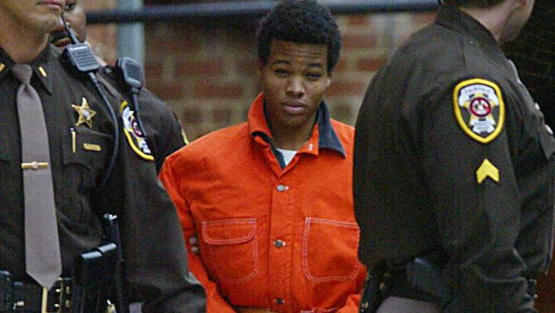 Sniper suspect Lee Malvo (c) leaves a pre-trial hearing at the Fairfax County Juvenile and Domestic Relations Court 04 December 2002 in Fairfax, Virginia.