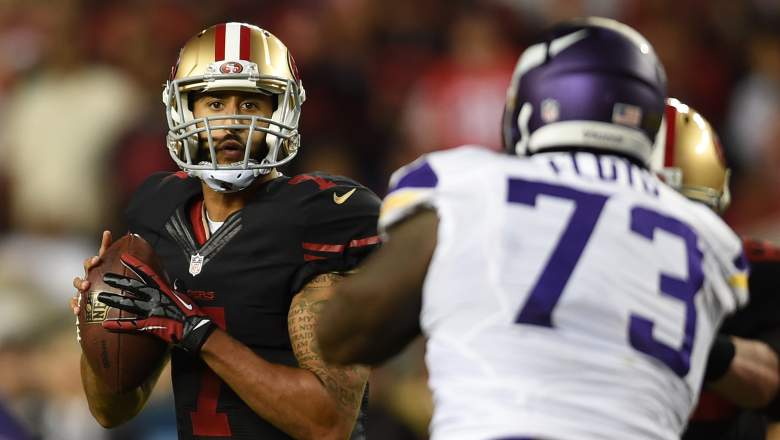 Colin Kaepernick drops back with a Vikings player pursuing