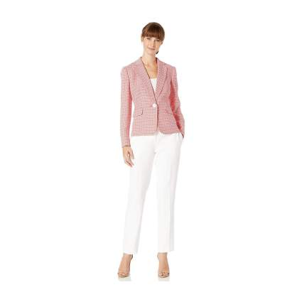 Woman in pink and white suit