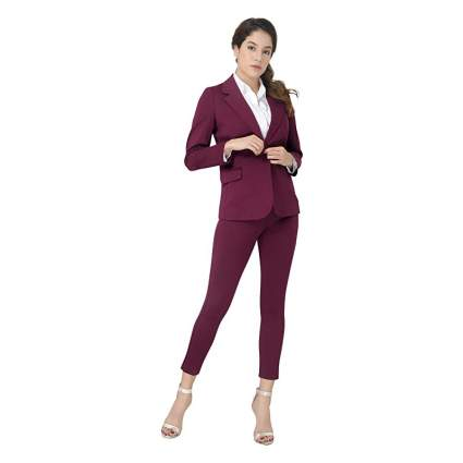 Woman in dark red suit with tight pants