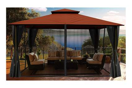 outdoor gazebo with curtains and screen