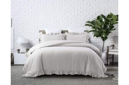Bed with light grey duvet and shams