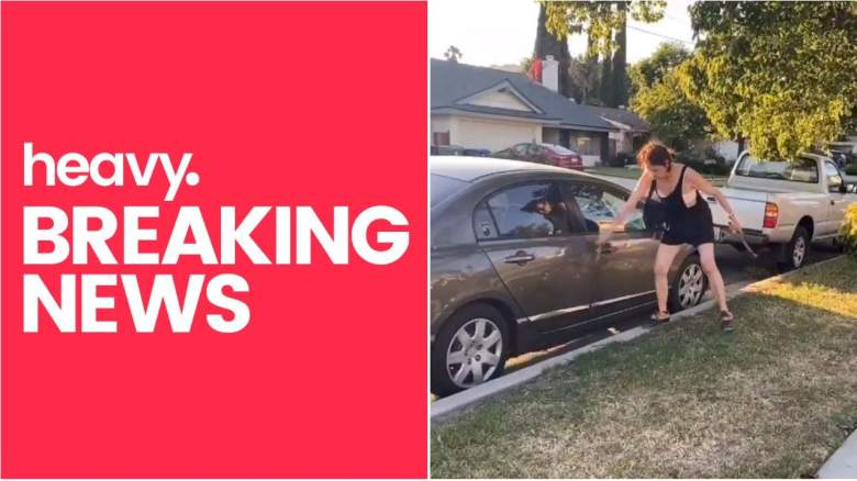 Woman Hitting Car With Hammer
