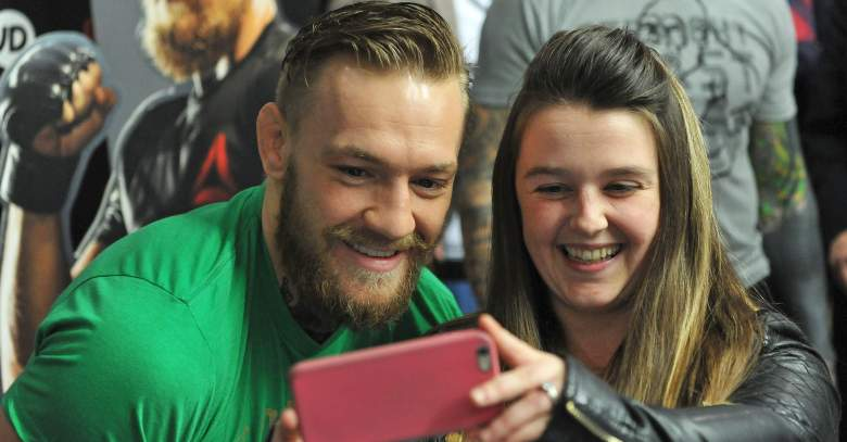 Conor McGregor with fan at Reebok event.
