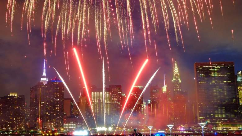 The Empire State Building and the Christal Building are seen during the Macy's 4th of July fireworks show from Queens, New York on July 4, 2017.