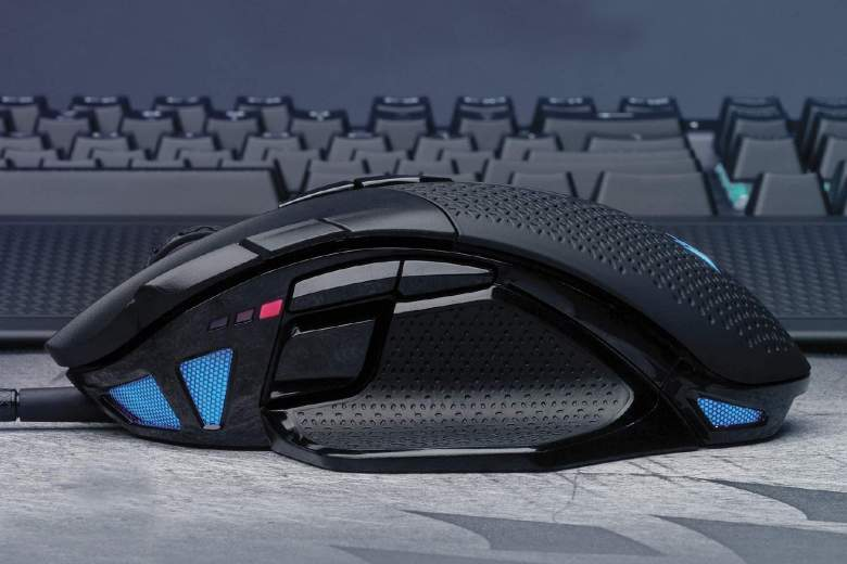 A Corsair wired gaming mouse in front of a keyboard