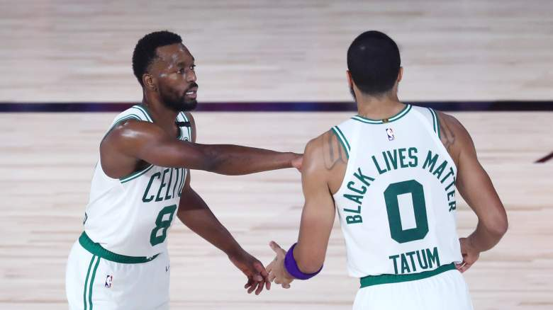 Celtics star Kemba Walker, at left, encourages young star Jayson Tatum