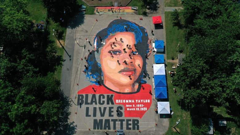 In an aerial view from a drone, a large-scale ground mural depicting Breonna Taylor with the text 'Black Lives Matter' is seen being painted at Chambers Park on July 5, 2020 in Annapolis, Maryland. The mural was organized by Future History Now in partnership with Banneker-Douglass Museum and The Maryland Commission on African American History and Culture. The painting honors Breonna Taylor, who was shot and killed by members of the Louisville Metro Police Department in March 2020.