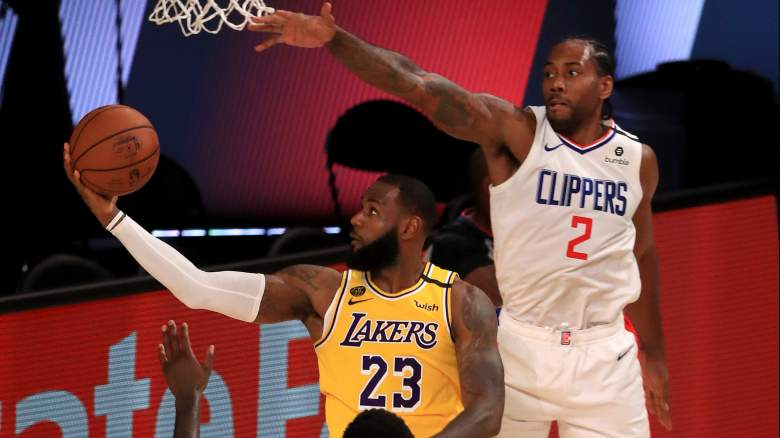 The absence of Kawhi Leonard, at right, of the Clippers from Saturday's game sparked NBA conspiracy theories.