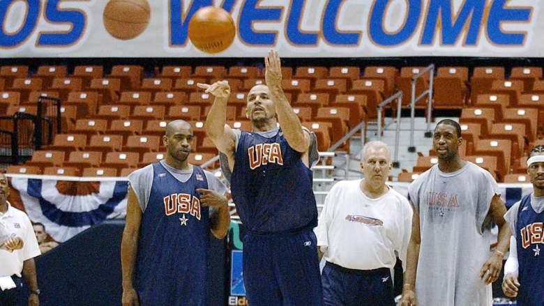 Jason Kidd, center, takes a shot as Gregg Popovich, in white, looks on.