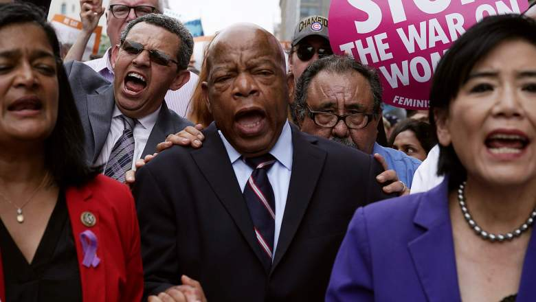 U.S. Rep. Pramila Jayapal (D-WA), President of CASA in Action Gustavo Torres, Rep. John Lewis (D-GA), Rep. Raul Grijalva (D-AZ) and Rep. Judy Chu (D-CA) march to the headquarters of U.S. Customs and Border Protection during a protest June 13, 2018 in Washington, DC.
